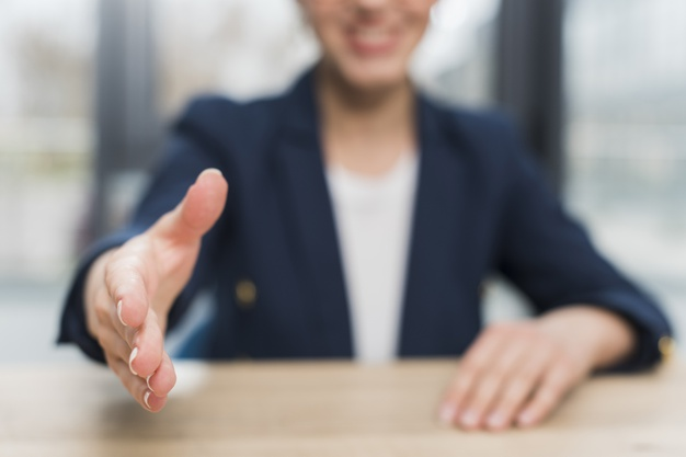 front-view-defocused-woman-offering-hand-shake-after-being-hired_23-2148507845